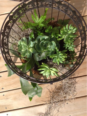 Very easy to plant in a cage that opens at the top. Image source: http://dee-vidabela.blogspot.com/2014/07/diybirdcage-planter.html